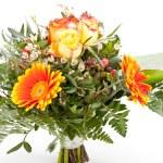 Vivid orange gerbera daisy in a bouquet — Stock Photo