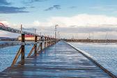 Bridge stretching  an expanse of sea — Stock Photo