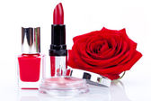 Fashionable cosmetics with red rose — Стоковое фото