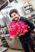 Chef holding flowers — Stock Photo