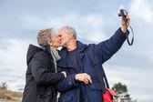 Elderly couple taking a self portrait — Stock Photo