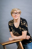 Attractive senior woman wearing glasses — Stock Photo