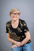 Charming senior woman wearing glasses — Stock fotografie
