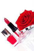 Fashionable cosmetics with red rose — Stock Photo
