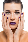 Attractive woman with purple lips and nails — Stock Photo
