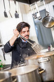 Chef stirring a pot of stew or casserole — Stock Photo