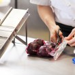 Chef slicing boiled beetroot — Stock Photo #47009109
