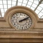 Clock in a stone building facade — Stock Photo #47009249