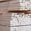 Wooden panels stored inside a warehouse — Stock Photo #47009901
