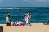 Woman selling seashells on a beach in Bali — Stock Photo