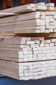 Wooden panels stored inside a warehouse — Stock Photo