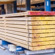 Wooden panels stored inside a warehouse — Stock Photo #47010355