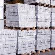 Cement building blocks stacked on pallets — Stock Photo #47010487
