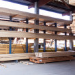 Wooden panels stored inside a warehouse — Stock Photo #47010639