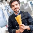 Attractive friendly chef preparing spaghetti — Stock Photo