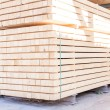 Wooden panels stored inside a warehouse — Stock Photo #47010895