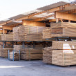 Wooden panels stored inside a warehouse — Stock Photo #47010995