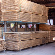 Wooden panels stored inside a warehouse — Stock Photo #47011089