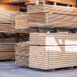 Wooden panels stored inside a warehouse — Stock Photo #47011773