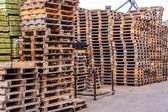 Stacks of old wooden pallets in a yard — Stock Photo