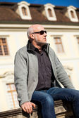 Stylish man in sunglasses enjoying the sun — Stock Photo
