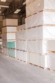Cement building blocks stacked on pallets — Stock Photo