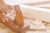 Handheld wood plane with wood shavings — Stock Photo
