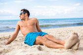 Handsome man relaxing on the beach — Stock Photo