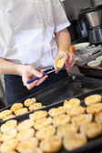 Chef preparing desserts removing them from moulds — Stock Photo