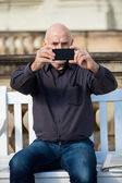 Man taking a photograph with his mobile — Stock Photo