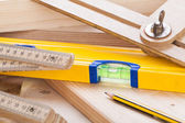 Carpenters level, ruler and right angle — Stock Photo