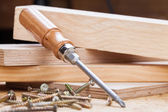 Phillips head screwdriver and wood screws — Stock Photo