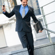 Businessman walking down stairs — Stock Photo #48670141