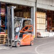 Постер, плакат: Forklift parked at a warehouse