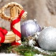 Christmas baubles on branch — Stock Photo #48671735