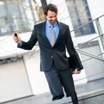 Businessman walking down stairs — Stock Photo