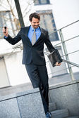Businessman walking down stairs — Foto de Stock