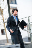 Businessman walking down stairs — Stock Photo