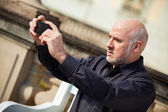 Man taking a photograph with mobile — Stock Photo