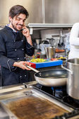 Chef taking a call on his smartphone — Stock Photo