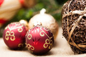 Shiny red and gold baubles — ストック写真