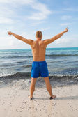 Man in blue swim shorts — Stock Photo