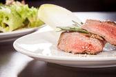 Succulent medium rare beef steak — Stock Photo