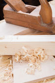 Handheld wood plane with wood shavings — Foto de Stock