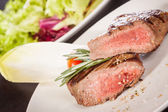 Succulent medium rare beef steak — Stock Photo