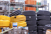 Rolls of plastic pipes — Stock fotografie