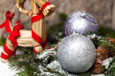 Christmas baubles on branch — Stock Photo