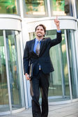 Motivated businessman pointing up — Stock Photo