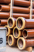Several pipes stacked in yard — Stock Photo