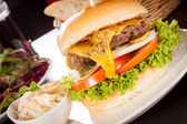 Cheeseburger with coleslaw — Stock Photo